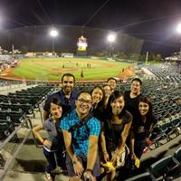 Dr. Brian Park (front row) enjoys a Sacramento River Cats game this summer with friends, including former optometry school classmates.