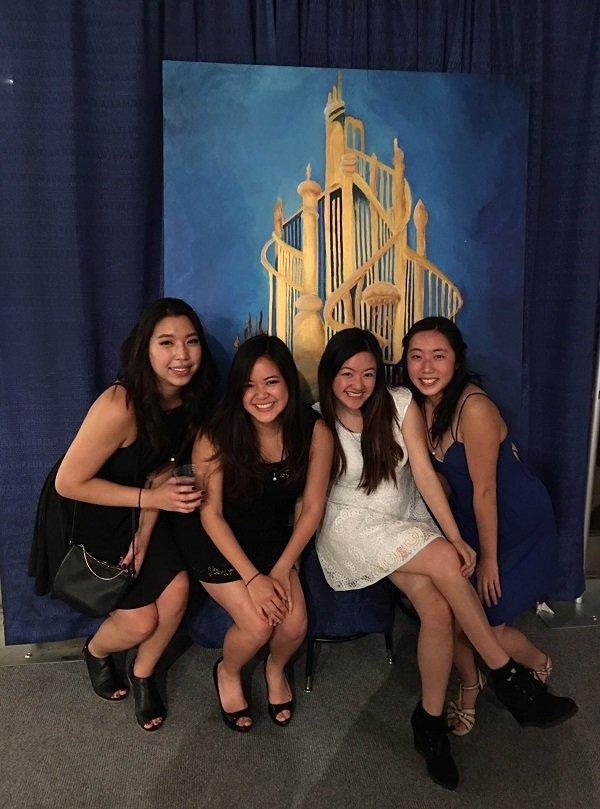 Mina Choi (far right), first-year student at University of California – Berkeley School of Optometry, with friends at the 2016 EyeBall semi-formal. The four of them painted the mural behind them.