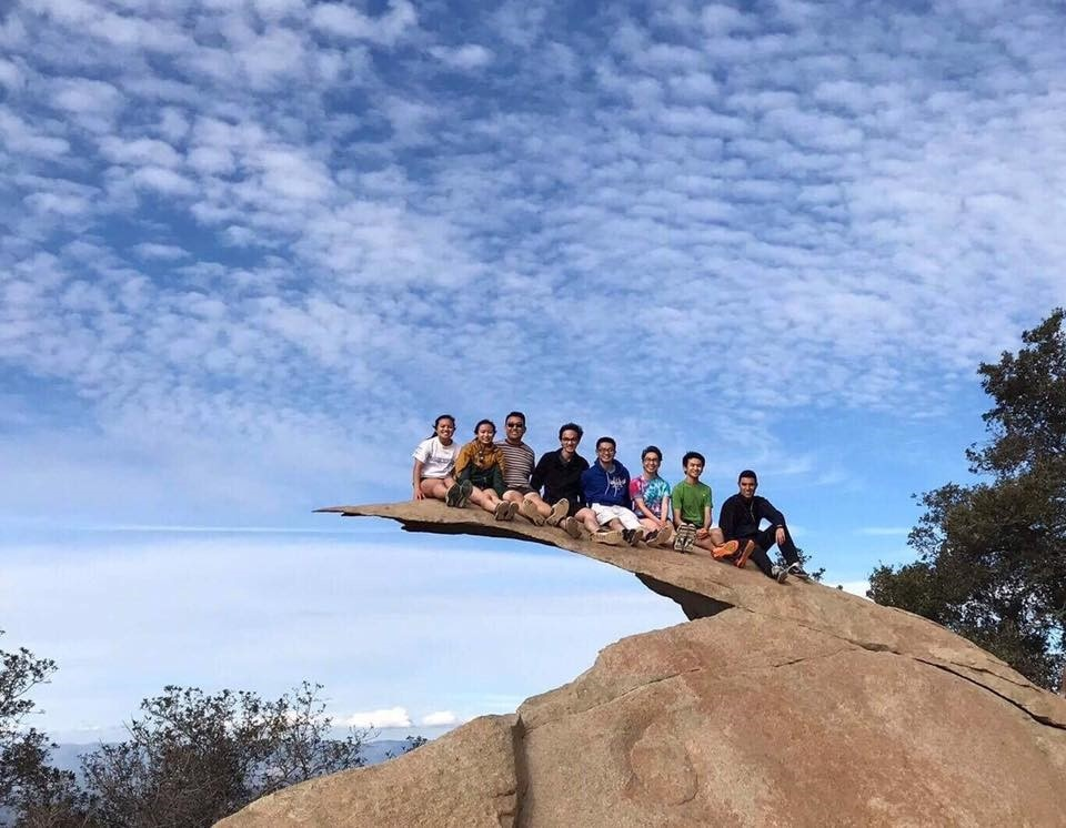 Members of UCSD Insight Pre-Optometry Club hiking at Potato Chip Rock in San Diego