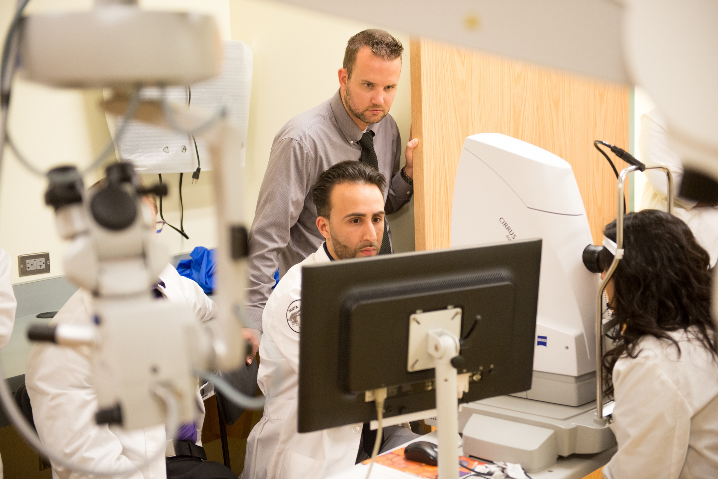Students and faculty at the University of the Incarnate Word Rosenberg School of Optometry's Bowden Eye Care and Health Center review optical coherence tomography results.