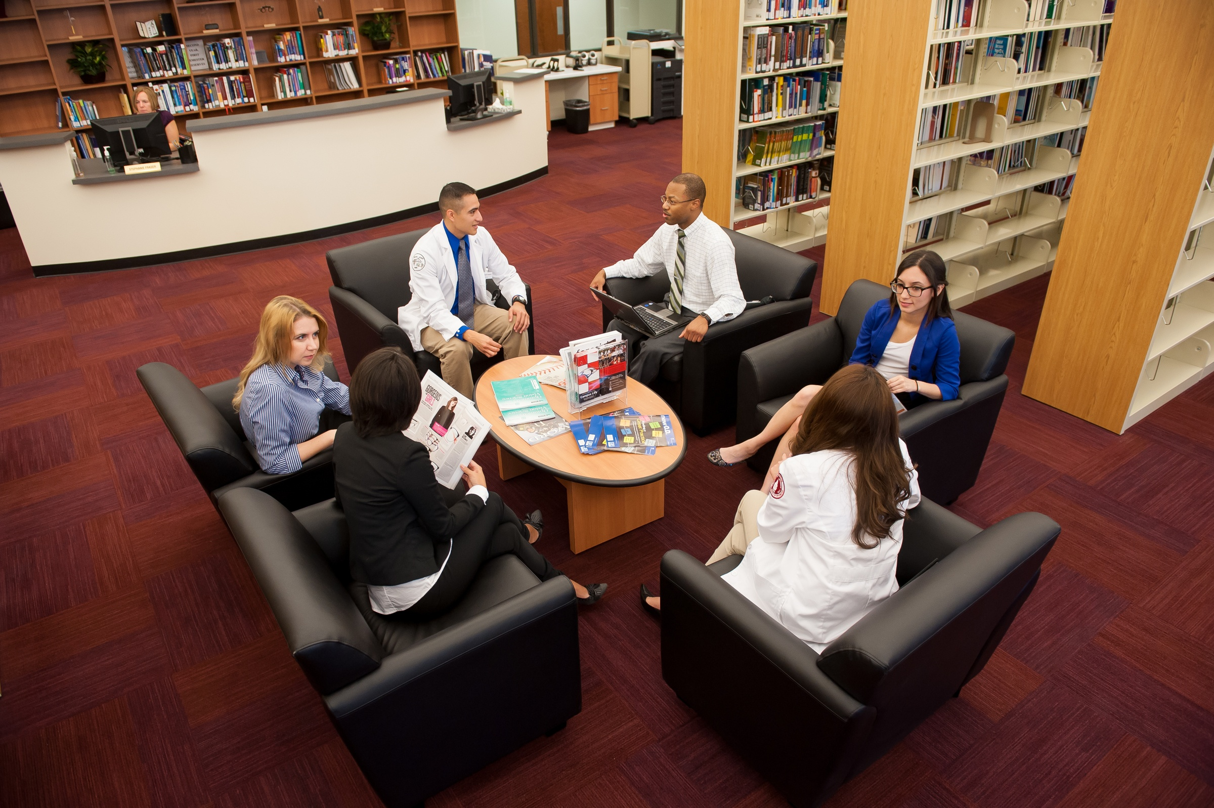 A group of students meets at the George W. Brackenridge Library at the Rosenberg School of Optometry.